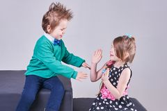Beautiful little boy and girl clap their hands and smile. For any purpose Royalty Free Stock Photo