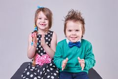 Beautiful little boy and girl clap their hands and smile stock image
