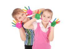 Beautiful little boy and girl with hands in the paint Royalty Free Stock Photos