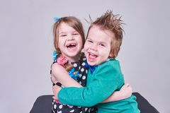 Beautiful little boy and girl, have fun screaming and hugging. For any purpose Royalty Free Stock Photo