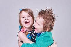 Beautiful little boy and girl, have fun screaming and hugging. For any purpose Royalty Free Stock Photography
