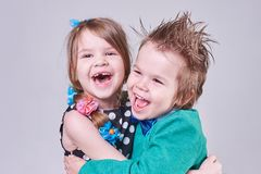 Beautiful little boy and girl, have fun screaming and hugging. For any purpose Royalty Free Stock Image