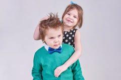 Beautiful little boy and girl hugging stock photo