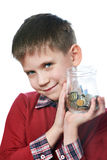 Beautiful little boy with glass jar of coins isolated Royalty Free Stock Images