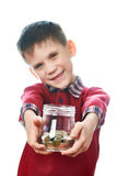 Beautiful little boy with glass jar of coins isolated Stock Photos