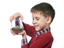 Beautiful little boy with glass jar of coins isolated Royalty Free Stock Image