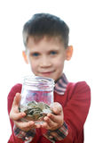 Beautiful little boy with glass jar of coins isolated Stock Image