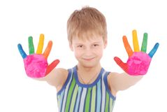 Beautiful little boy with hands in the paint Stock Photo