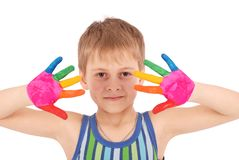 Beautiful little boy with hands in the paint Stock Photography