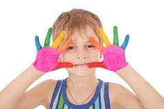 Beautiful little boy with hands in the paint Royalty Free Stock Images