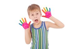 Beautiful little boy with hands in the paint Royalty Free Stock Photo