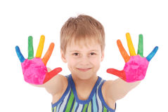 Beautiful little boy with hands in the paint Stock Photos