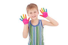 Beautiful little boy with hands in the paint Stock Images
