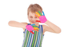 Beautiful little boy with hands in the paint Royalty Free Stock Image