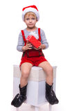 Beautiful little boy holding present from Santa Claus. Christmas Stock Photo