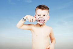 Beautiful little boy looking through a magnifying glass Royalty Free Stock Photos
