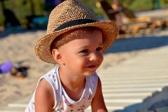 Beautiful little boy smiling on the beach stock photos