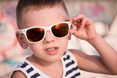 Beautiful little boy in trendy sunglasses in summer Royalty Free Stock Image