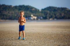 Little boy on the beach Stock Photography
