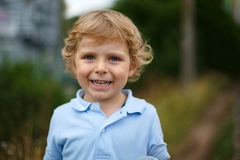 Beautiful little boy walking on a country road Stock Photography