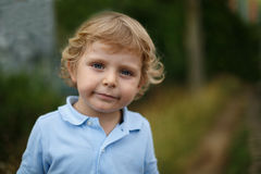 Beautiful little boy walking on a country road Royalty Free Stock Image