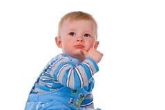 Beautiful little boy a white background stock photo