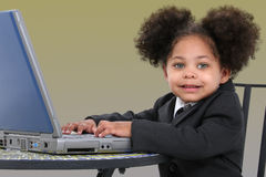 Beautiful Little Business Woman Working On Laptop Royalty Free Stock Photography