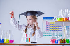 Beautiful little chemist works in laboratory Stock Images