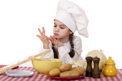 Beautiful little chief cooker on the desk with vegetables Royalty Free Stock Images