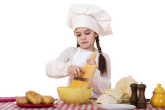 Beautiful little chief cooker on the desk with vegetables Stock Photography