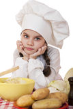 Beautiful little chief cooker on the desk with vegetables Stock Images