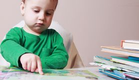 Beautiful little child girl learns to read success, education,. Childhood, development Royalty Free Stock Photography