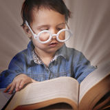 Beautiful little child girl learns to read success, education, Royalty Free Stock Photo