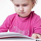 Beautiful little child girl learns to read success, education,. Childhood, development Stock Image