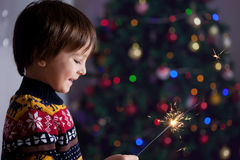 Beautiful Little child holding burning sparkler on New Year's Ev Stock Image