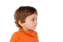 Beautiful little child two years old with orange jersey Royalty Free Stock Image