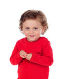 Beautiful little child two years old with red jersey smiling Stock Photos
