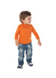 Beautiful little child two years old wearing jeans and orange je Stock Photo