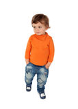 Beautiful little child two years old wearing jeans and orange je Stock Photos