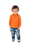 Beautiful little child two years old wearing jeans and orange je Royalty Free Stock Image
