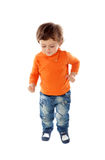Beautiful little child two years old wearing jeans and orange je Stock Photography