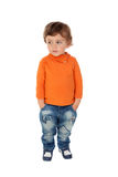 Beautiful little child two years old wearing jeans and orange je Royalty Free Stock Photos
