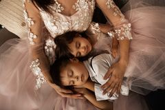 Beautiful little children sleep in mom`s knees royalty free stock photo