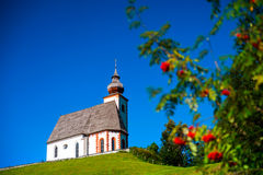 Free Beautiful Little Church In Alps. Sunny Day, Green Grass On The H Stock Photography - 79810252