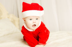 Beautiful little cute baby girl on Christmas. Beautiful young couple that made a wonderful family and have cute baby girl. beautiful wife and husband hug his royalty free stock photography