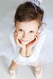 Beautiful little dancer, ballerina in white dress Stock Photo