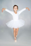 Beautiful little dancer, ballerina in white dress Stock Photography