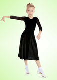 Beautiful little dancer in a black dress. The slender little blonde girl dancer in the long dress of black color made specifically for performing .The girl held royalty free stock photography