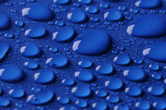 Beautiful little drops on blue Stock Images