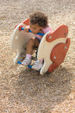 Beautiful little ethnic girl tired. From playing at the playground in the park Royalty Free Stock Photography